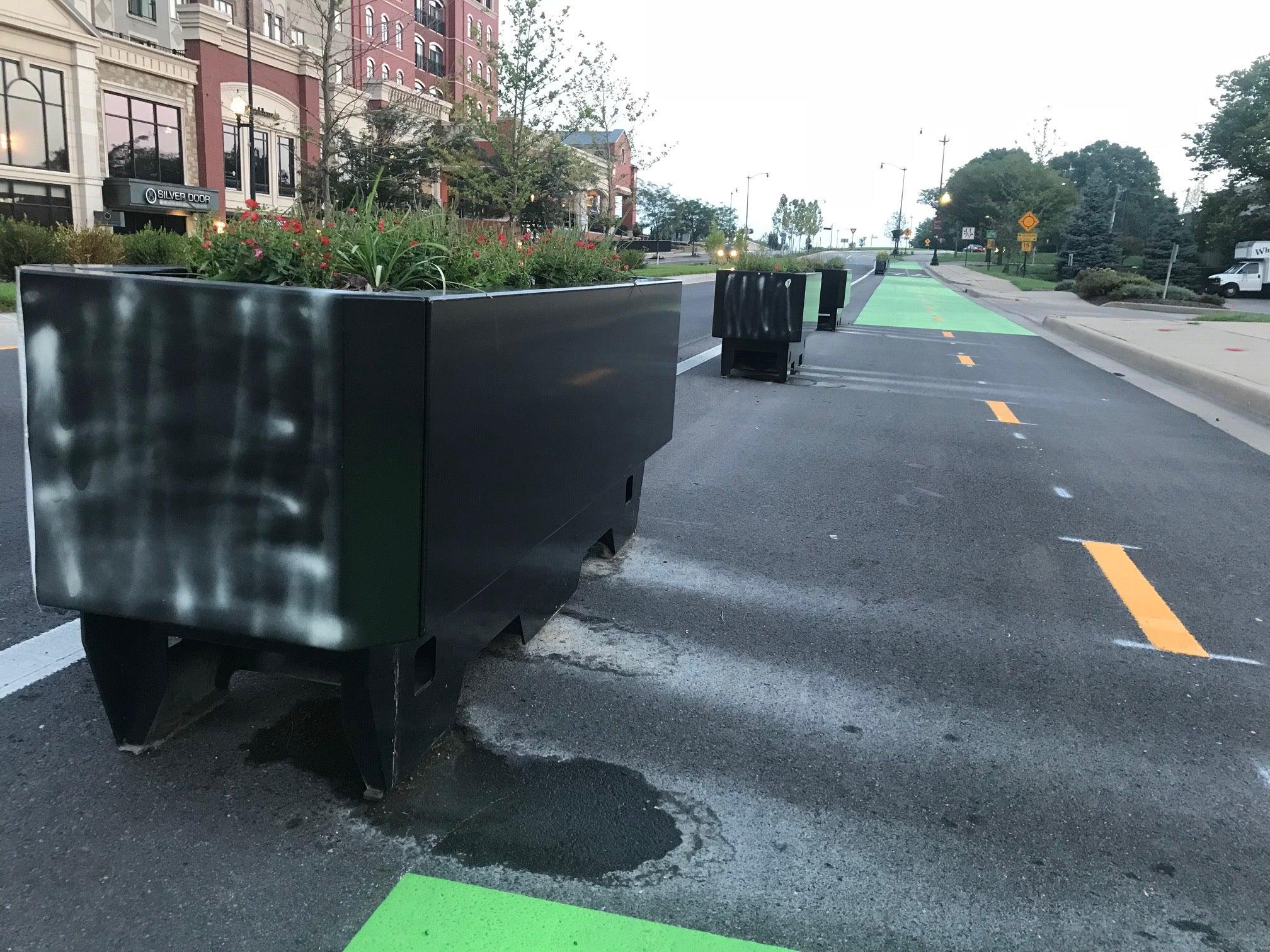 vandalized planters on Carmel bike lane